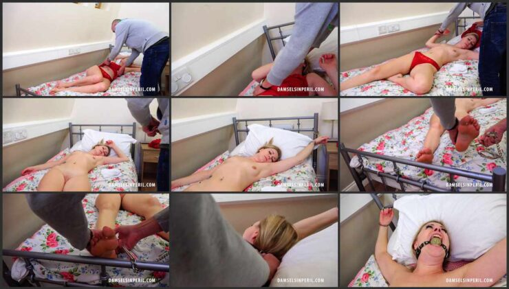 Stripped Lucy Cuffed and Ball-Gagged Chained to Bed