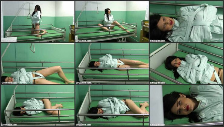 Yasmine – Green Straitjacket on a Bondage Bed