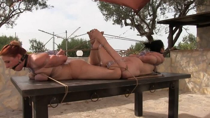 Two hot milf slave girls tied up, balggaged and punished outdoor