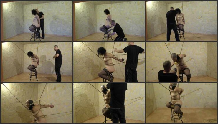 Minuit on chair tied to the ceiling and sponge gagged
