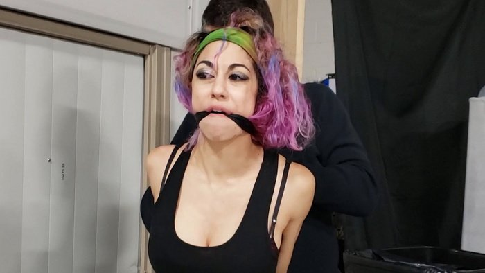 Desperately, Simone Squirmed and Thrashed with a Very tight Wrap Gag