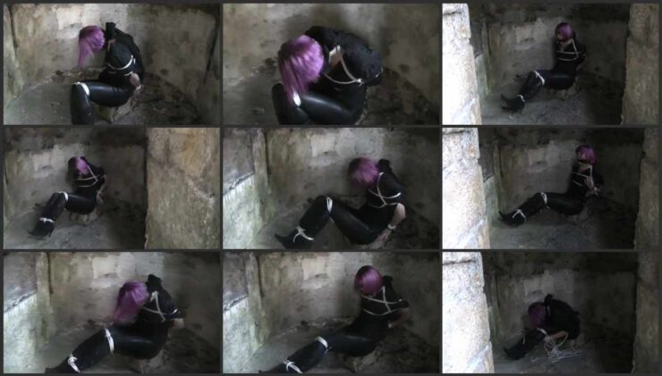Tracey in an old ruined building bound and gagged