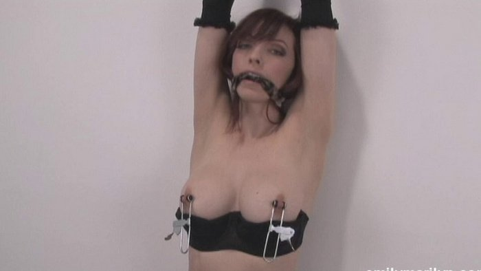 Tied damsel with nipple clamps