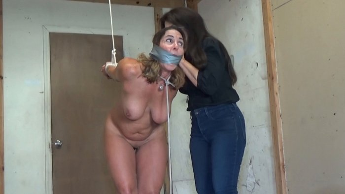 Naked MILF with big tits strappado in the garage
