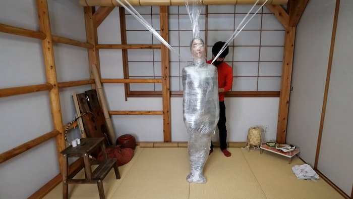 Fetish mummification for Hinako with Plastic Wrap creating a spider web style Part 2