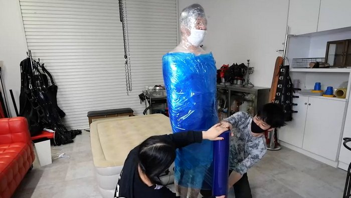 Video with Two Guys One with the Mummification Experience Mummifies the Other