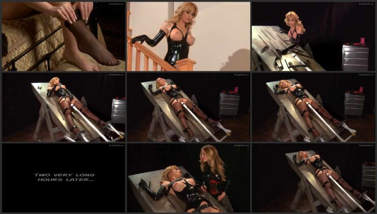 Angela in a latex corset on the automated self bondage table. Chapter 3. wmbcv-0735