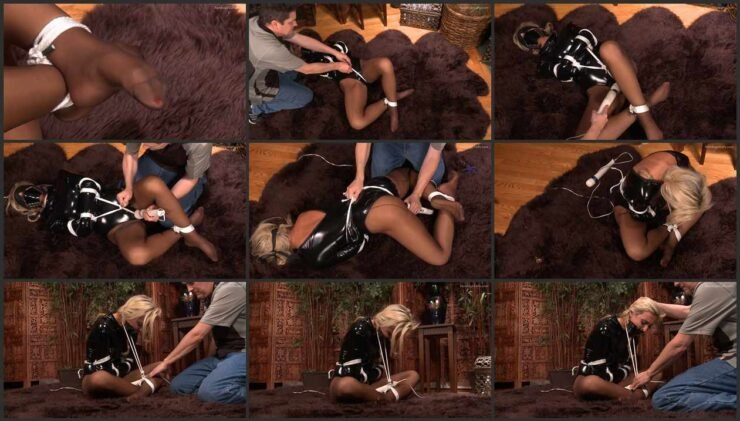 Carolina trussed in stretchy black latex straitjacket. wmbcv-1014
