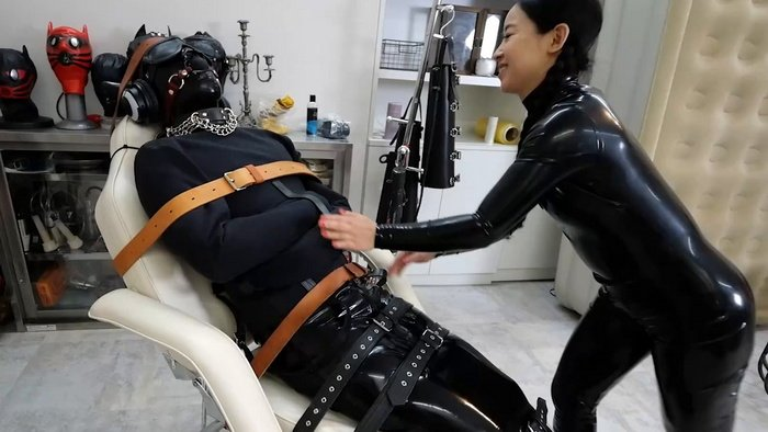 Tied to the chair slave in Latex Catsuit and Straitjacket