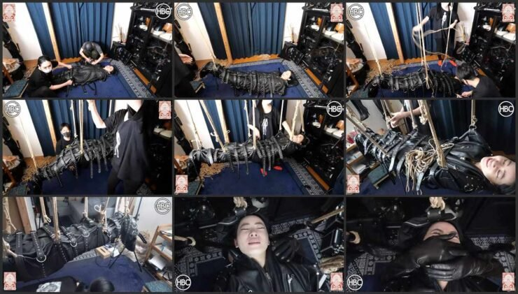 Hinako in leather clothes tied and suspended leather sack