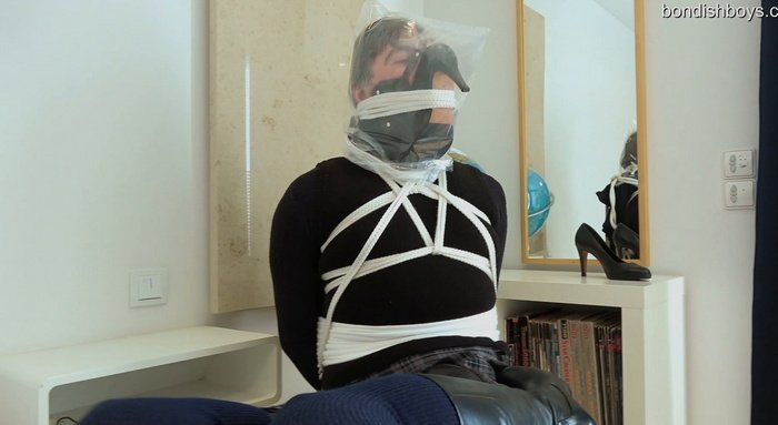 No-nonsense bondage on a chair with rope, plastic bag and gag harness