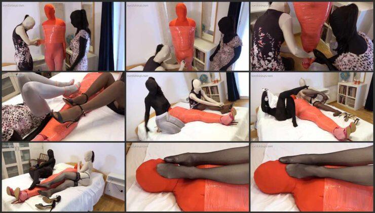 Two nylon mistress Paula and Sandra mummified her slave