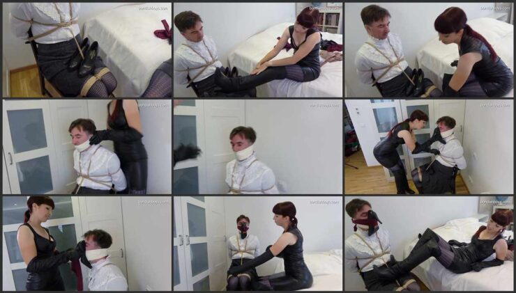 Slave is tied to a chair and gagged in high-heeled boots and worn pantyhose