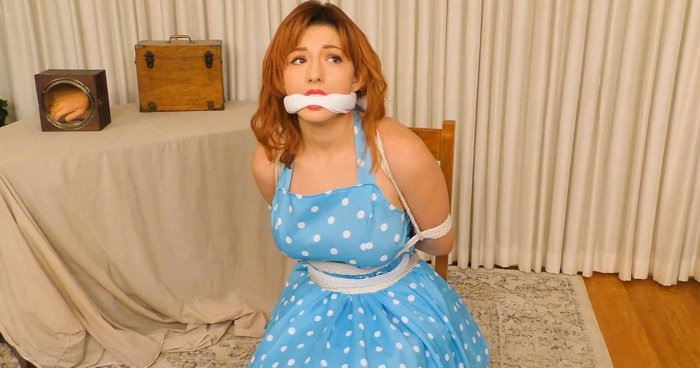 Redhead Keely struggles and moans bound to a chair by a gorilla. Damsels In A Haunted House – Part Two