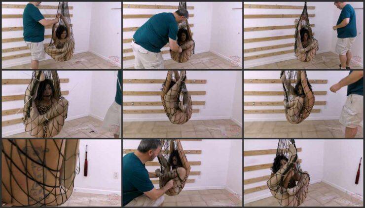 Kim stuck inside of a fishing net in helpless position