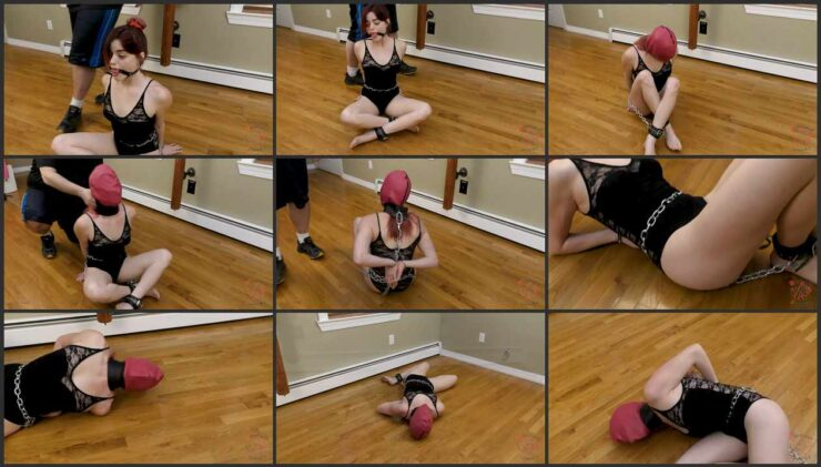 Sage in completely helpless, tied with blindfold and a leather hood