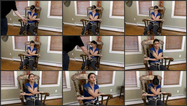 Lily is tied to a chair in the forced experiment with the magic wand