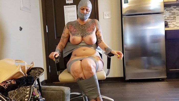 Ava with natural breasts, taped tightly to the chair
