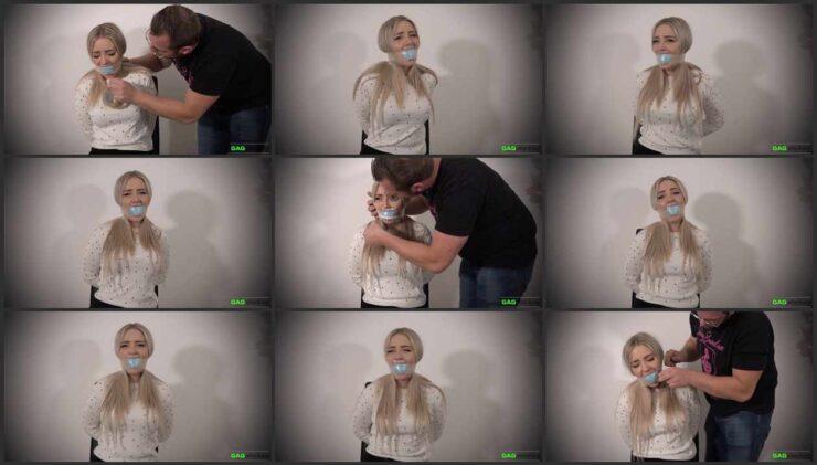 Aubrey's mouth stuffed a pair socks PVC tape gag and tegaderm tape