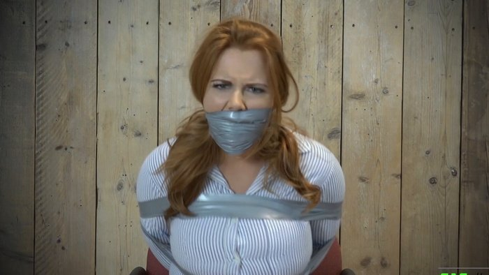 Lisa is no way she can get out of this tape bondage or get the secured gag off
