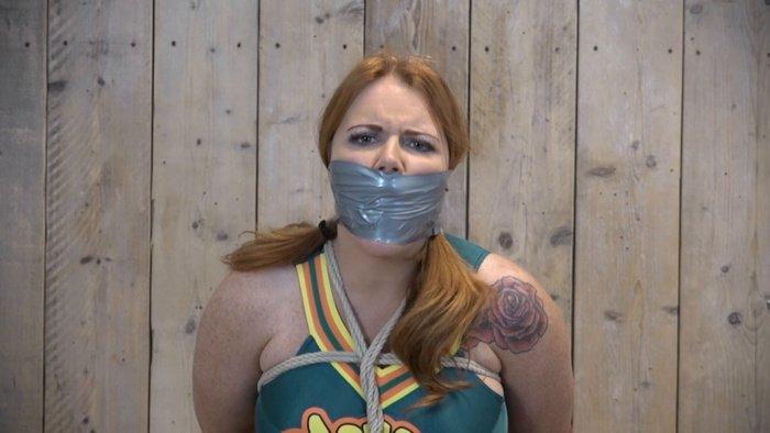 Cheerleader Lisa very helpless in this gags