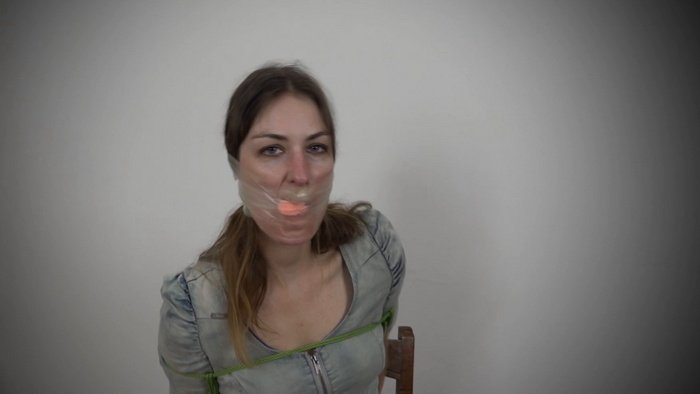 Lola Pearl with her hands tied behind her back and PVC tape on her face