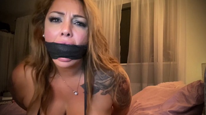 Rara is dressed in a tight black catsuit in very hot sexy self gag clip