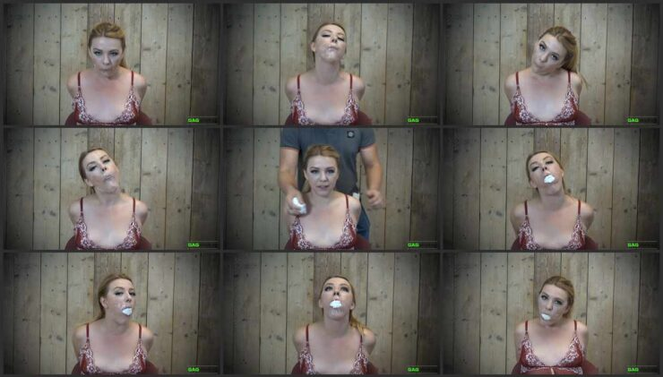 Two Gag Video with Kate Stardust, her hands tied behind her back and her mouth gagged tegaderm tape
