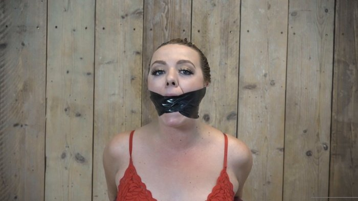 Kate Stardust incapable of talking, her mouth gets stuffed with a sock and around silver PVC tape wrapped