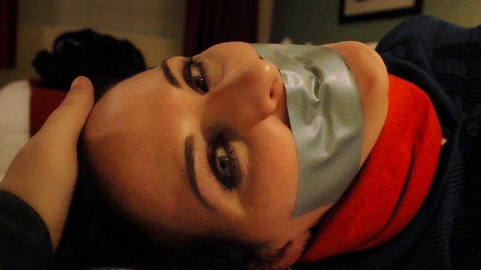 Caroline wriggles in pleasure bound and gagged on the bed