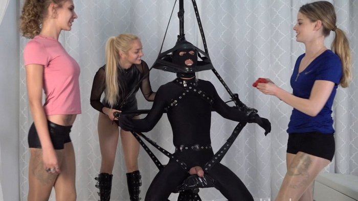 Boy in vicious rigging and trio cute mistresses play with his cock