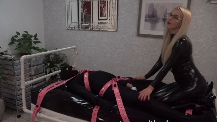 Tied tightly to the bed with straps and goes through the cycle of hell again with a vibrator