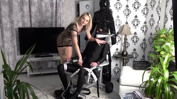 Slave tied to a chair and a vibrator between his legs