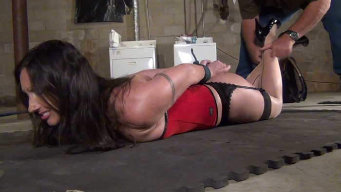 Wenona tightly roped up in Ivan's basement