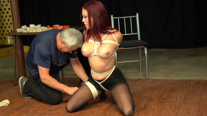 Very tight bondage for Sarah in sexy outfit