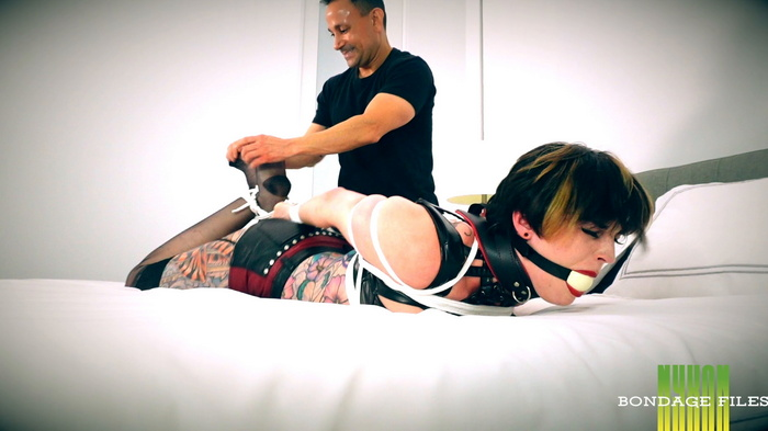 Leather collar on a Irene Silver and ropes on her body