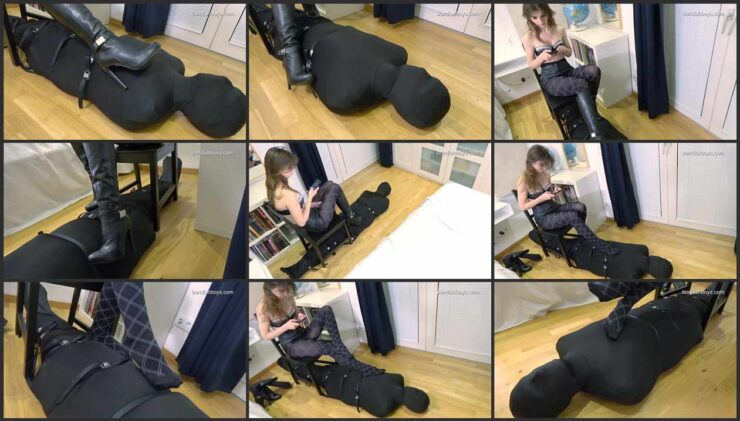The slave restrained with belts in a leather sleeping bag – a piece of furniture