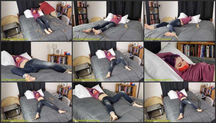 Jeanette's energetic struggling of bound and gagged on the bed