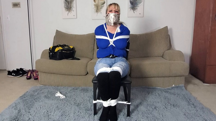 Lolly tightly tied to a chair and gagged
