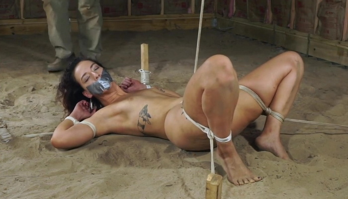Stevie's crotch roped with rope on a floor