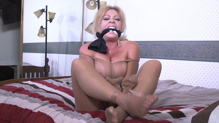 Busty Cleo's mouth is stuffed with panties