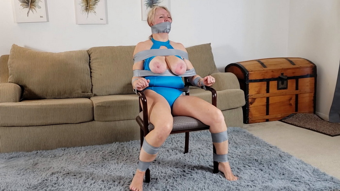 Professional model Sybil Starr taped to a chair in her own home