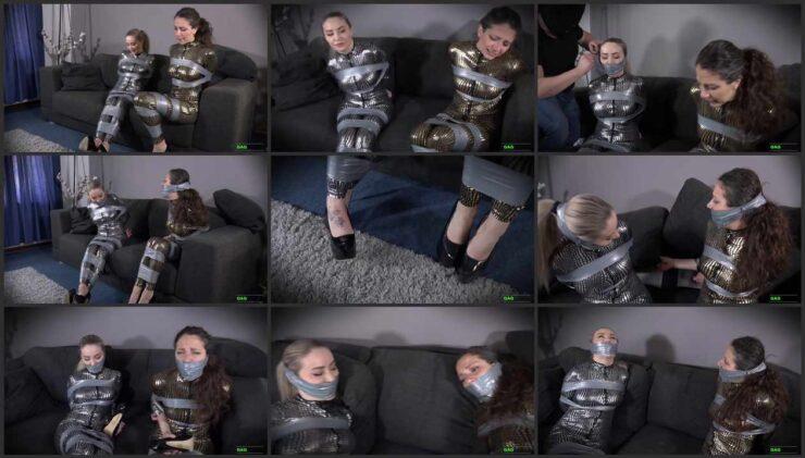 "Aubrey & Julia in ""abandoned"" building – Tape Bondage in Catsuit"