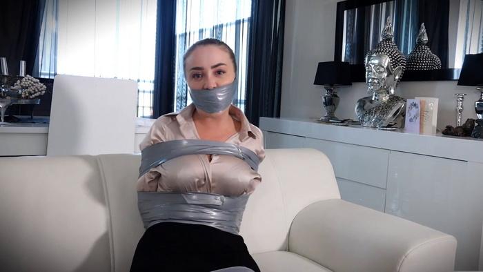 Sexy Secretary Aubrey is captured in Tape Bondage