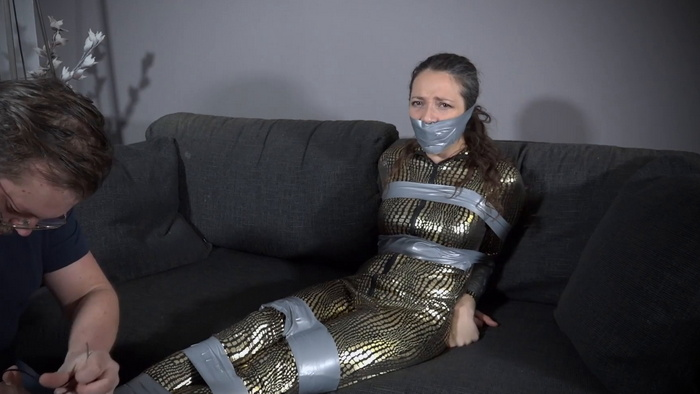 Julia is captive tied up and gagged with PVC tape