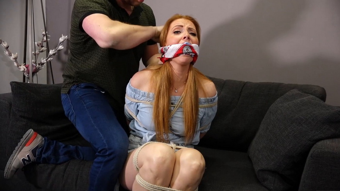 Mila struggles to get rid of the gag