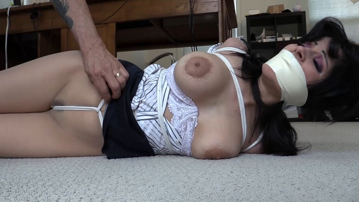 Secretary Hannah bound and gagged under a her desk