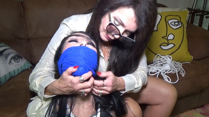 Busty brunette Luna Dawn hogtied & helpless