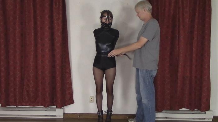 Hard Leather Bondage in a head harness gag for Madalynn