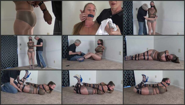 Pepper in a Electrical Tape and hogtie with her gag taped